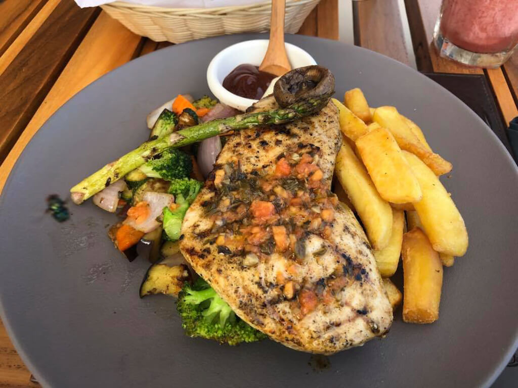Grilled salmon with orange and rosemary sauce, a main course at Almar Restaurant in Puerto Ayora, Isla Santa Cruz, Galapagos.