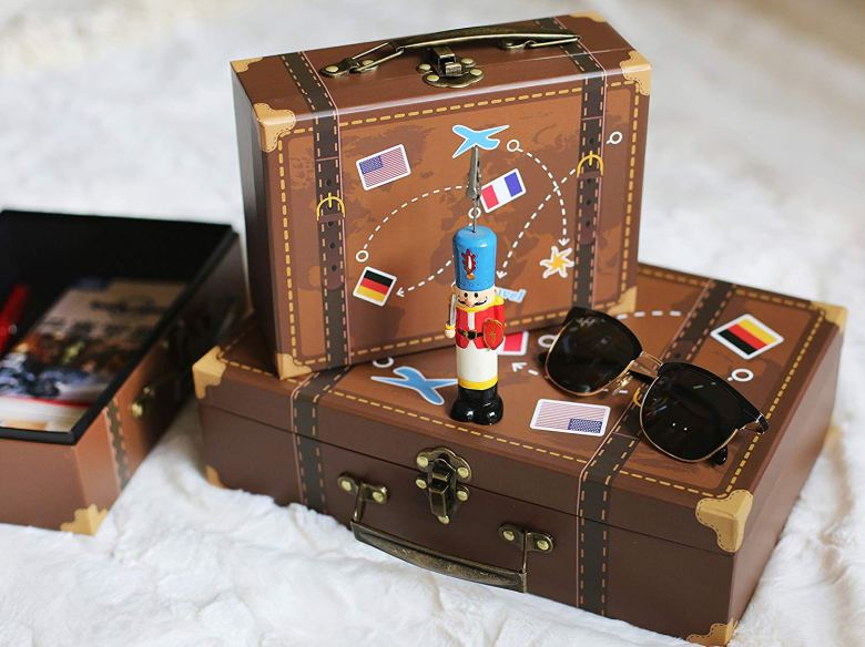 Travel suitcase centerpieces for destination bridal shower decoration.