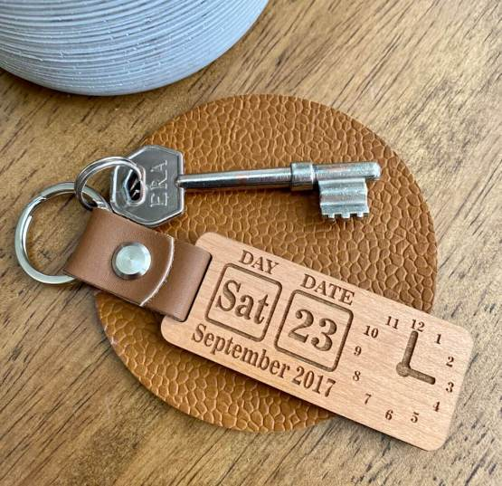 Our beautiful wooden keyring with a genuine leather strap can be personalised with that special date, and Time of that special day.