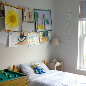 childs-room-budget-design-ideas-hanging-childs-paintings-Ideal-Home