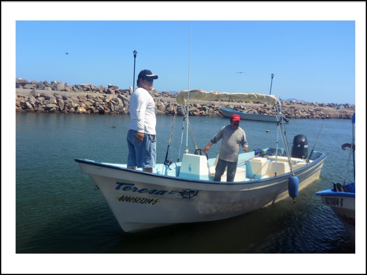 Jorge is at the helm, and his assistant is standing in the front of the boat.