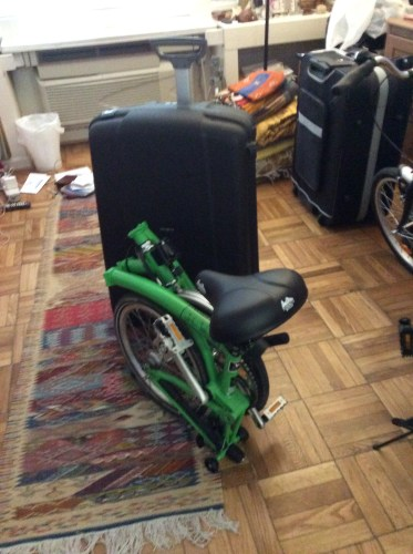 My Brompton bike in front of a Samsonite F'Lite GT Spinner 31