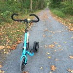 Blue Me-Mover on a gravel trail strewn with fall leaves