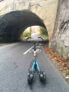 Blue Me-Mover in bike lane looking through arched tunnel
