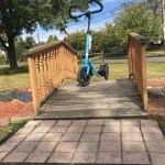 Blue Me-Mover on small wood landscaping bridge in a park