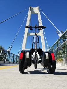 White Me-Mover ready to cross the white cable-stayed bridge over I-4 near the Seminole Wekiva Trail in Florida