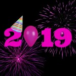 Pink 2019 with party hat on the two and pink fireworks against a black background
