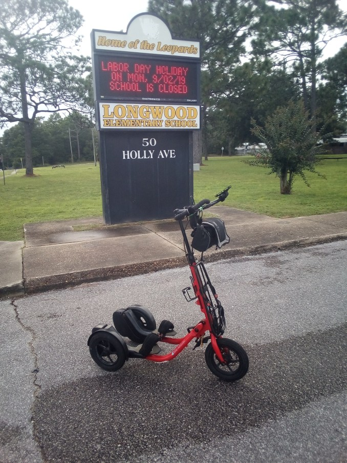 Red Me-Mover in front of the Longwood Elementary School's digital sign