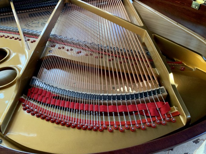 Ritmuller grand piano view of inside strings