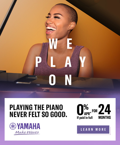woman sitting in front of grand piano singing