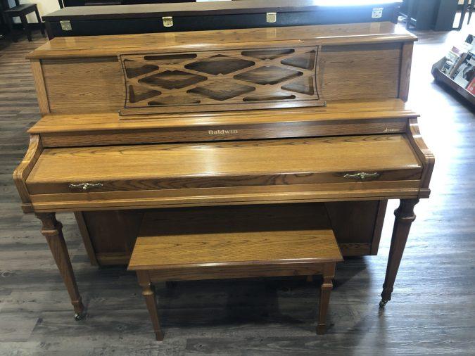 Front view of Baldwin 2075 piano in oak finish