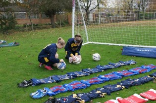 Girls preparing football kit