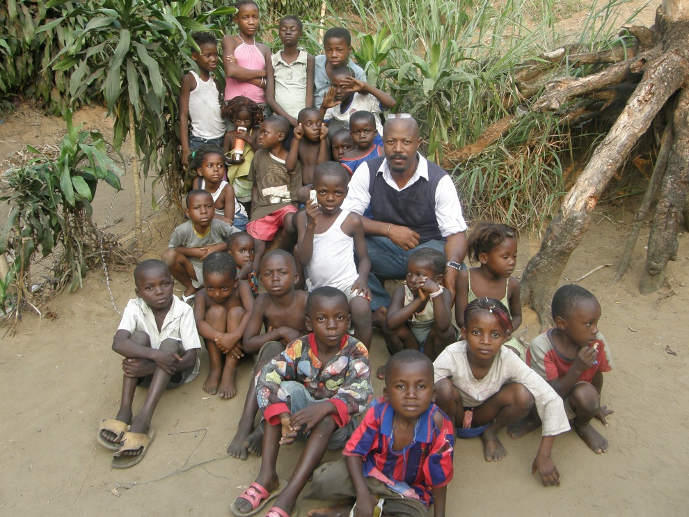 Children sitting on the ground with Theodore