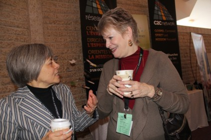 Marge Warkentin (l) and Chris Klassen from La Salle (Man.) Community Fellowship share stories during coffee break at Assembly 2014. Photo by Gladys Terichow