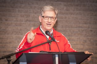 """Mennonite Brethren Collegiate Institute, Winnipeg, president Fred Pauls addresses delegates on Friday night: """"At MBCI, we're thankful for the opportunity to proclaim the lordship of Christ everyday."""" Photo by Carson Samson"""