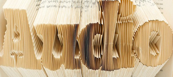 book pages folded to look like the word audio
