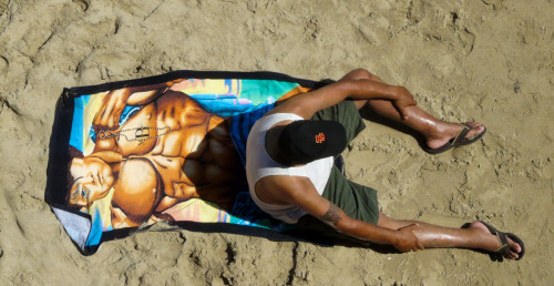 man_on_beach_towel