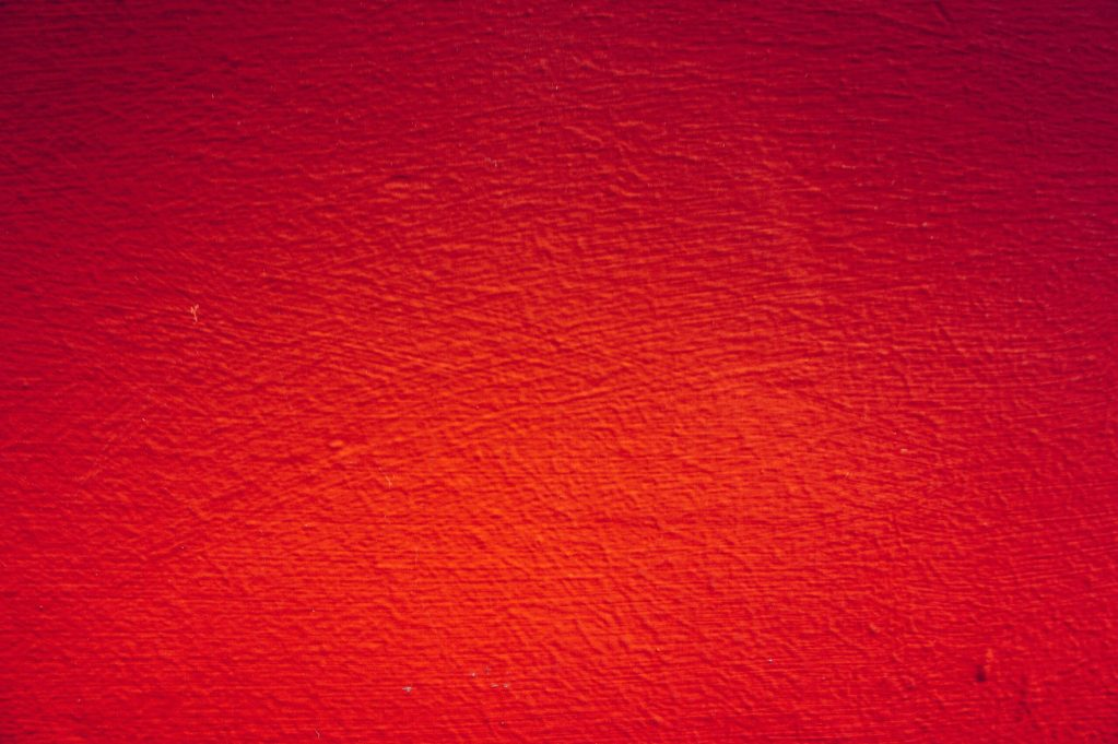 red painted wall in close up photography