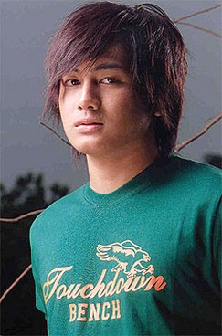 Cute Looking Asian Man With Layered Hairstyle And Long