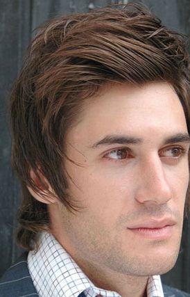 Layered Medium Haircut For Men Brown Hair With Swept Bang