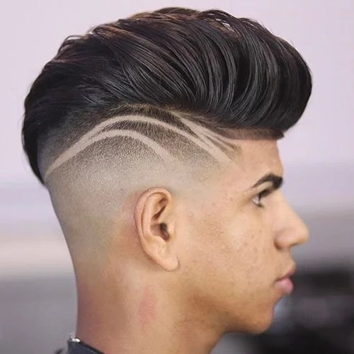 With A Higher Fade Than Usual This Tapered Cut Creates Dramatic Contrast Between Closely Shaved Sides And Longer Curls On Top A Razor Line Each Side