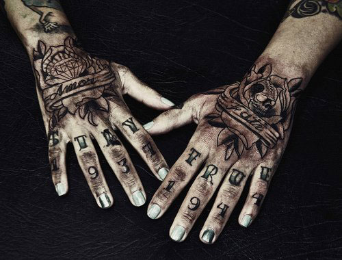 Black Hand Tattoo Designs