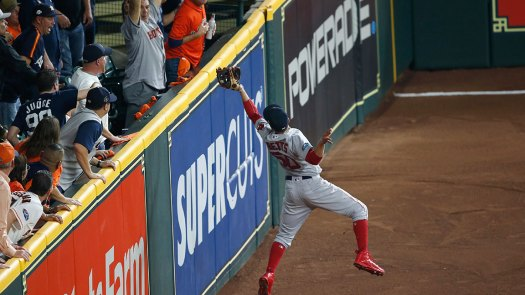 Mookie Betts #50 of the Boston Red Sox makes a leaping catch at the wall against the Houston Astros in the sixth inning of Game Five of the American League Championship Series at Minute Maid Park on October 18, 2018 in Houston, Texas. (Photo by Tim Warner/Getty Images)