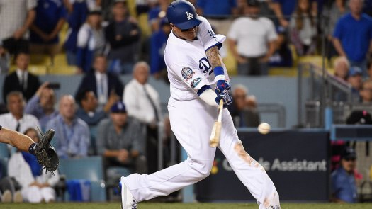 Manny Machado #8 of the Los Angeles Dodgers hits a double to left field during the ninth inning of Game Three of the National League Championship Series against the Milwaukee Brewers at Dodger Stadium on October 15, 2018 in Los Angeles, California. (Photo by Kevork Djansezian/Getty Images)