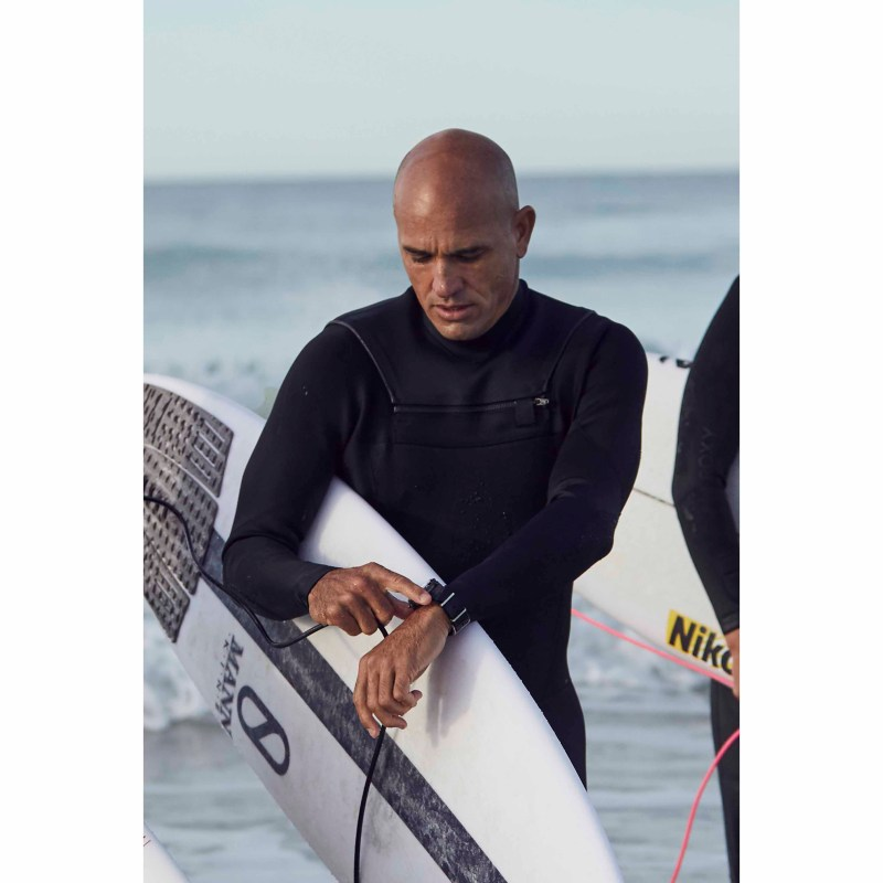 Breitling Surfers Squad member Kelly Slater wearing his Superocean Heritage II Chronograph 44 Outerknown
