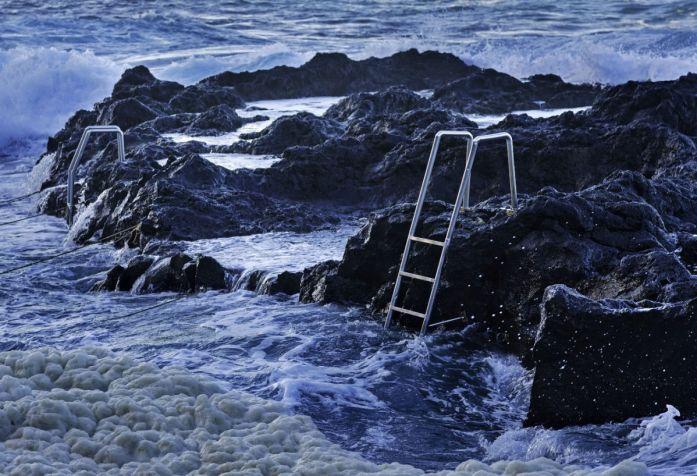 Ocean waves and stairs in public pool of Termas da Ferraria