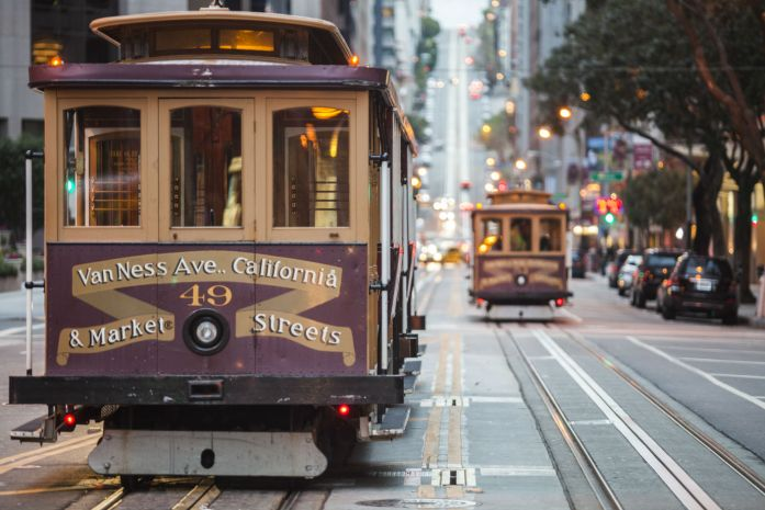 Cable cars on city street, San Francisco, California, USA