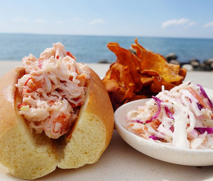 A lobster roll, slaw, and chips from Duryea Lobster Deck in Montauk, NY