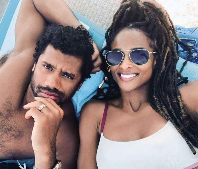 Instagram ready: Russell Wilson poses with his wife, Ciara.