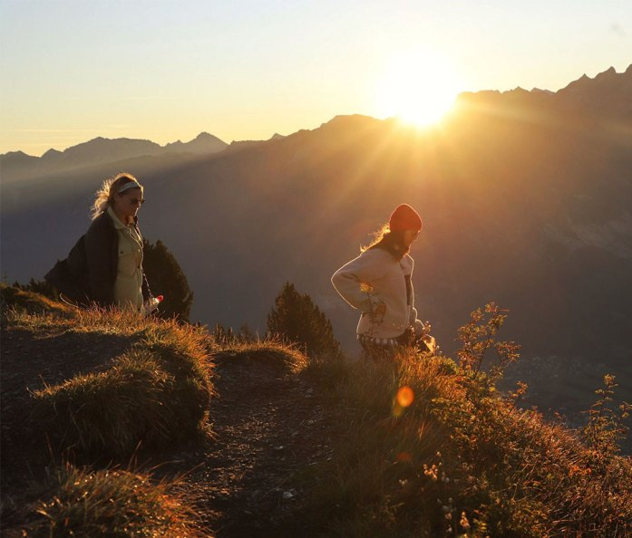 Hiking down the side of Gonzen mountain at sunrise
