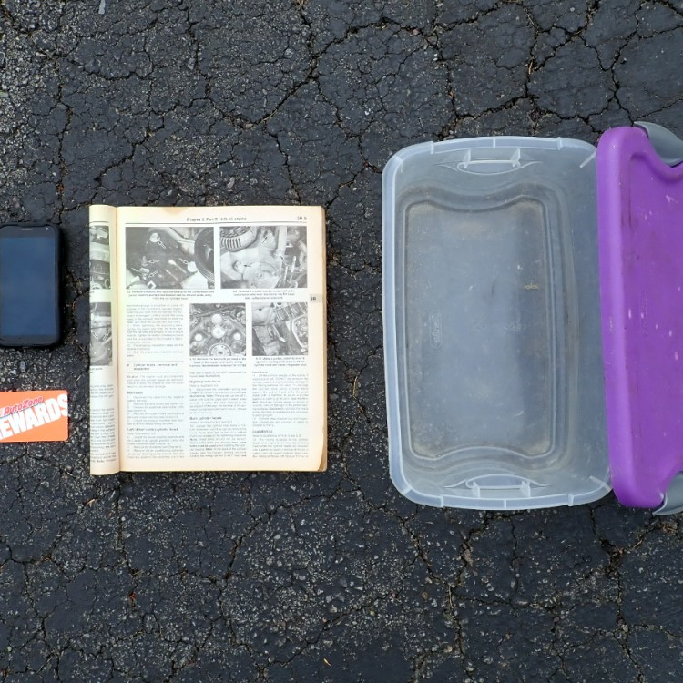 Phone, rewards card, manual, storage bin.