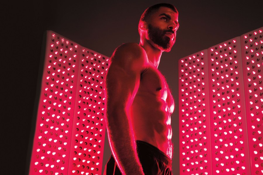 Man using Joovv infrared light therapy to recover post-workout