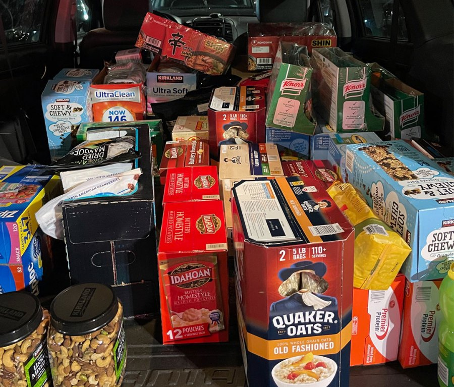 Car trunk filled with endurance fuel like Quaker Oats, granola abars, and nuts