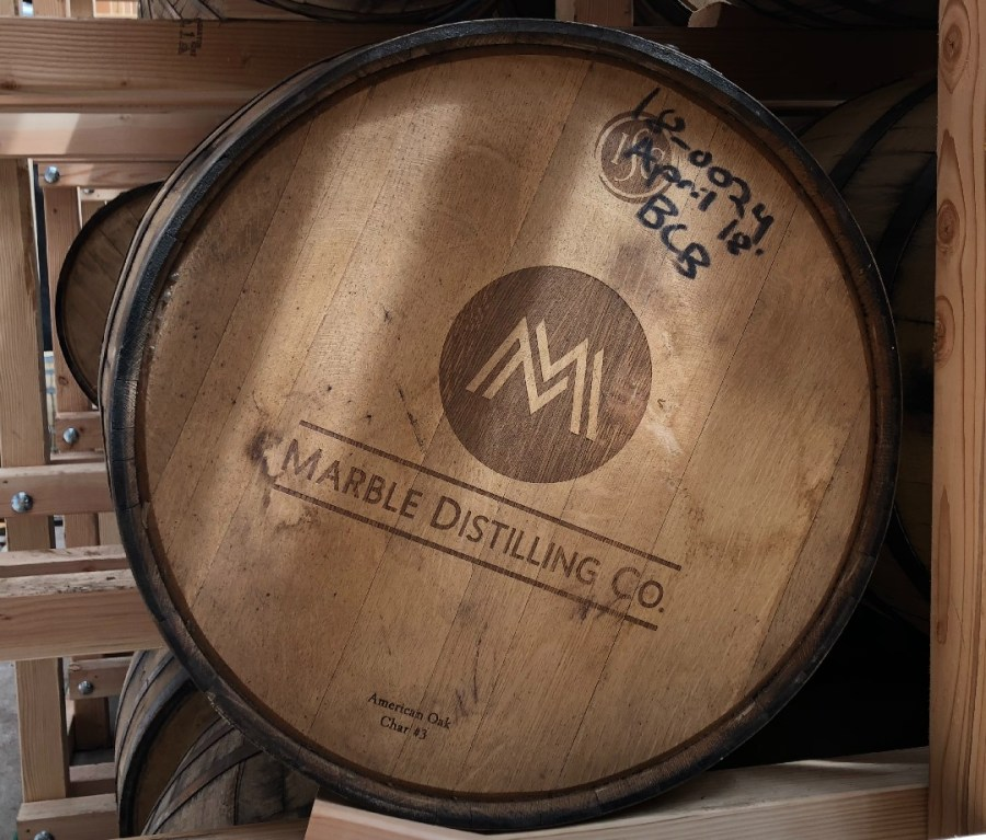 A top-view of a cask with the Marble Distilling Co. logo on it.