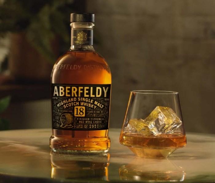 Bottle of Aberfeldy 18-Year-Old Red Wine Cask-Finished Single Malt Scotch Whisky beside filled glass
