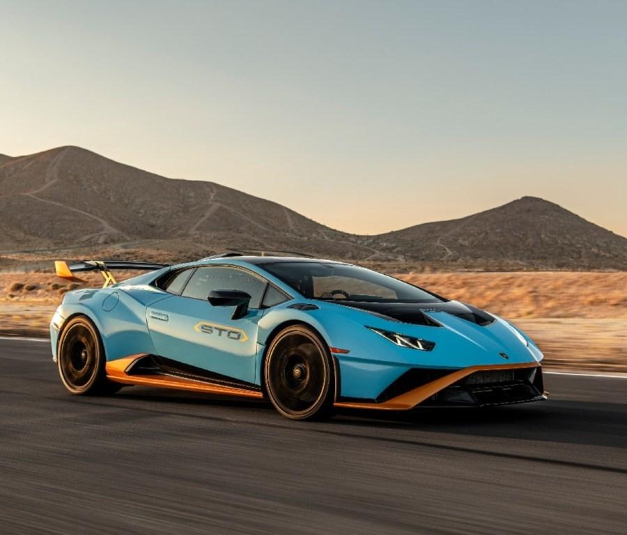 Side profile of blue 2021 Lamborghini Huracán STO on a race track