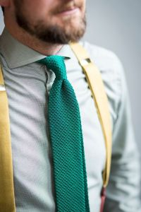 Blue men suit with brown knitted tie