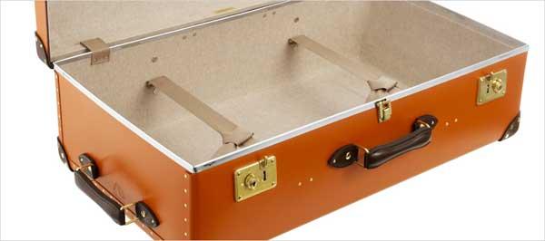 the centenary globetrotter suitcase orange