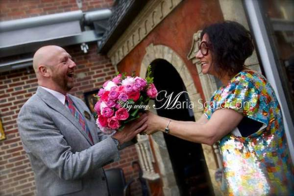 Harvey Nichols - Man handing flowers at Gracie Opulanza