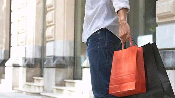 Man posing with shopping bags