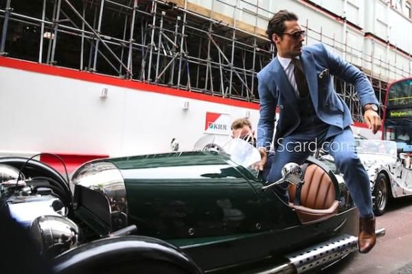 David Gandy stepping out of a 3 wheeler Morgan