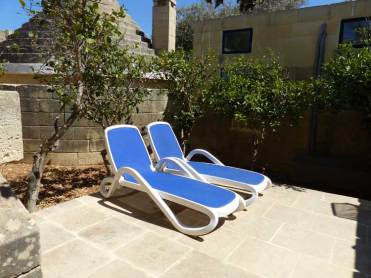 Patio with sun loungers
