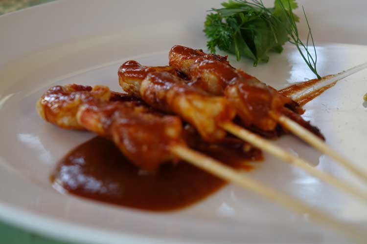 Sate Udang, grilled prawn kebabs with peanut sauce, lawar vegetables and steamed rice