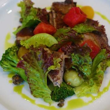 Lukewarm salad of comfit duck leg, green lentils and citrus vinaigrette