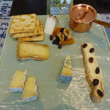 Trio of French cheese with condiments