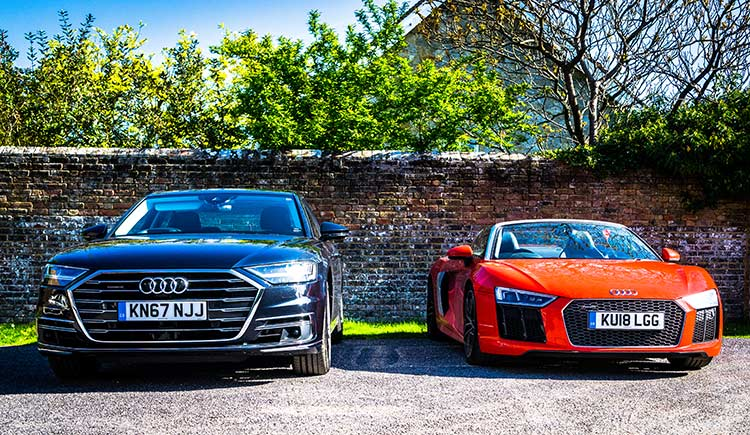 Audi A8 and R8 sitting side by side